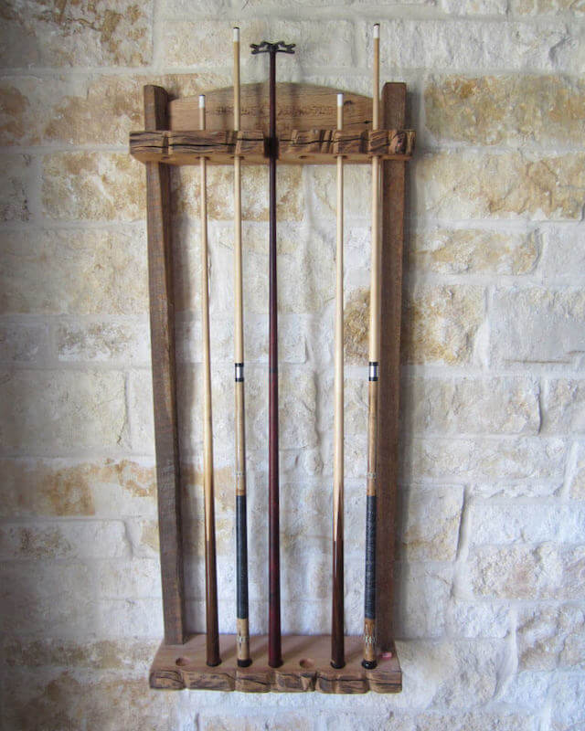 reclaimed barn wood billiard cue rack on stone wall